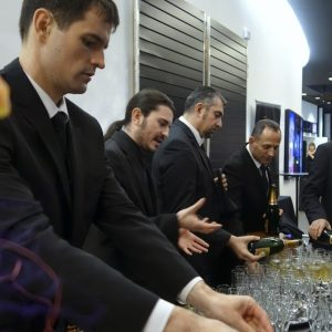 Butlers providing first class service at a drinks reception